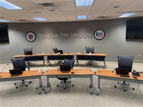 Photo of Board room with seats spread out